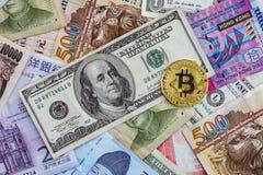 Golden bitcoin on international banknote, bitcoin electronic mon Stock Photos