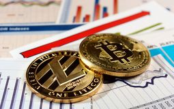 Bitcoin and litecoin on rise graph. A golden bitcoin and litecoin on graph and diagrams background. concept of trading crypto currency Royalty Free Stock Photos