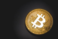 Golden bitcoin logo. Glows in lights Stock Photo