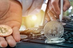 Golden Bitcoin Medal on keyboard with light of success financial. In sights into investment finance business concept stock image