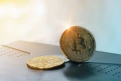 Golden Bitcoin Medal with light of success financial concept. Golden Bitcoin Medal with light of success financial in sights into investment finance, Bitcoin stock photography