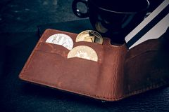 The golden bitcoin, men`s purse credit card. Cryptocurrency bitcoin coins. Litecoin, Bitcoin, Ethereum, e-commerce, busibess, finance concept crypto currency Royalty Free Stock Image