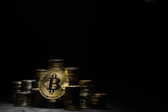 Golden bitcoin with money on balck background. Bit coin cryptocurrency banking money transfer business technology Stock Photos