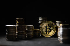 Golden bitcoin with money on balck background. Bit coin cryptocurrency banking money transfer business technology Royalty Free Stock Photos
