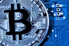 Golden Bitcoin money on computer. Stock Photos