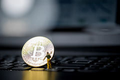 Golden Bitcoin money on computer. Stock Images