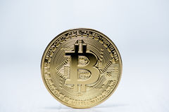 Golden Bitcoin money on computer. Royalty Free Stock Images