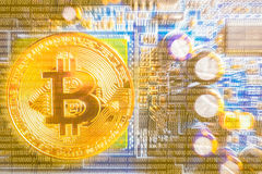 Golden bitcoin on motherboard computer background conceptual for crypto currency Stock Images