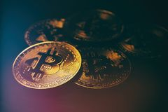 Golden Bitcoin over black background. Business concept. Stock Images