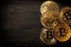 Golden Bitcoin over black background. Business concept. Stock Photos