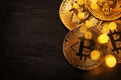 Golden Bitcoin over black background. Business concept. Royalty Free Stock Images