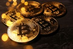 Golden Bitcoin over black background. Business concept. Stock Image
