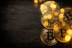 Golden Bitcoin over black background. Business concept. Stock Photo