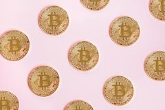 Golden Bitcoin, pattern with coins on pink background, cryptocurrency concept. Golden Bitcoin, pattern with coins on pink background, can be used as Stock Photography