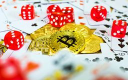 Golden bitcoin red dice and card, gambling concept.  Royalty Free Stock Photos