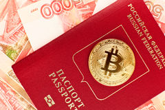 Golden bitcoin on russian passport Royalty Free Stock Photography