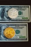 Golden bitcoin and silver litecoins on us dollars close up. stock photo