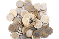 Golden bitcoin on stack of euro coins Royalty Free Stock Photo