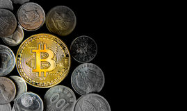 Golden Bitcoin surrounded by coins from various countries, on bl. Ack background. Flat lay with copy space Stock Image