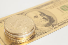 Golden bitcoin with U.S. dollar Stock Image