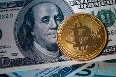 Golden Bitcoin on US dollar bills. Electronic money concept. The Golden Bitcoin on US dollar bills. Electronic money concept Stock Photos