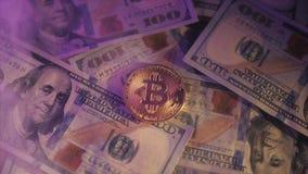 Golden bitcoin on us dollar bills electronic money exchange concept. Bitcoin lies on dollars. White smoke 60fps stock footage