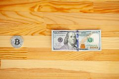Golden Bitcoin and US dollars. Digital currency.  stock photography