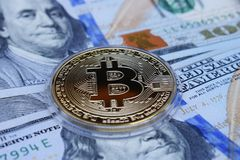 Golden Bitcoin on US dollars. Digital currency royalty free stock image