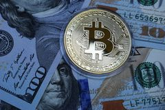 Golden Bitcoin on US dollars. Digital currency stock images