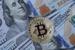 Golden Bitcoin on US dollars. Digital currency royalty free stock photography