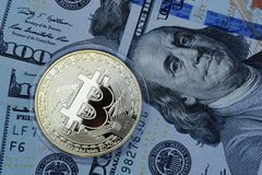 Golden Bitcoin on US dollars. Digital currency royalty free stock photos