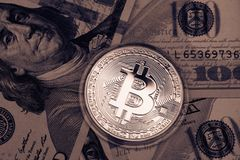 Golden Bitcoin on US dollars. Digital currency. royalty free stock photography