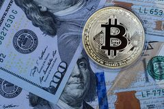 Golden Bitcoin on US dollars. Digital currency. stock photo