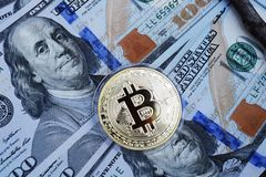 Golden Bitcoin on US dollars. Digital currency stock photos