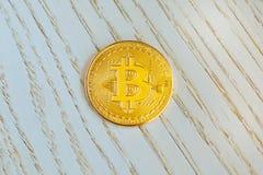 Golden bitcoin on white wooden background. Bitcoin crypto currency, Blockchain technology, digital money. Golden bitcoin on white wooden background. Bitcoin royalty free stock photos