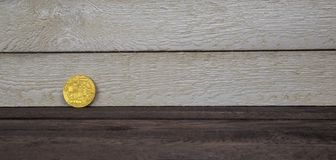 Golden bitcoin on wooden background. conceptual image for crypto currency royalty free stock photography