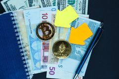 Golden bitcoin with yellow paper arrows on blue background. Internet e- commerce, security, risk, investment, business concept royalty free stock images