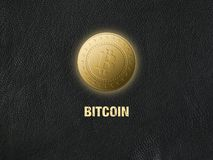 Golden bitcoins on black leather background. The Golden bitcoins on black leather background Royalty Free Stock Photography