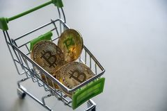 A golden bitcoins in a cart Royalty Free Stock Photos