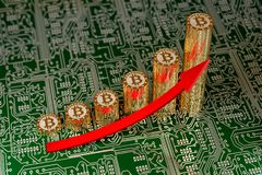 Golden Bitcoins on a circuit board Stock Images