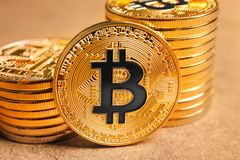 Golden bitcoins on color background, Stock Image