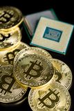 Golden bitcoins and CPU. royalty free stock image