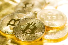 Golden bitcoins. Digital cryptocurrency. Royalty Free Stock Photos