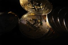 Bitcoins. Golden Bitcoins digital currency, financial industry, Black background royalty free stock photo