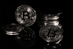 Bitcoins. Golden Bitcoins digital currency, financial industry, Black background stock photography
