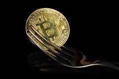 Golden bitcoins with fork. Hard fork change concept. Currency of the future Stock Photography