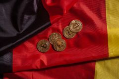 Golden bitcoins on german flag Stock Image