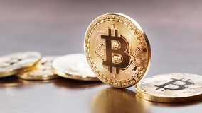 Bitcoin coin on table stock image