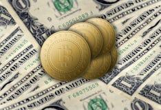 Golden bitcoins lie on dollars bills stock photos