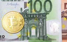 Bitcoins is a monetary denominations of 100 and 50 euros. Golden bitcoins is a monetary denominations of 100 and 50 euros stock photos